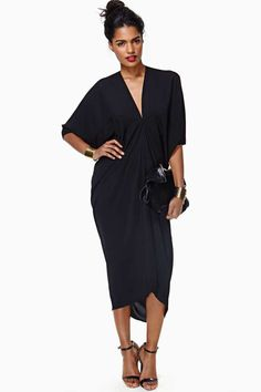 Gorgeous flowy black dress featuring a gathered waist and cool cocoon-like fit. Slinky fabric, unlined.