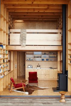 Elegant beach hut on sleds, so it can be easily moved! via It's Nice That