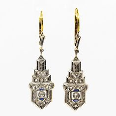 Period: Art Deco (1920-1935) Composition: 18k Gold & Platinum Stones: • 22 Rose cut diamonds H-VS2 0.30ctw. • 2 Single cut diamonds H-VS2 0.08ctw. • 4 Natural calibrated cut sapphires 0.10ctw. Earring measure: 42mm by 11mm Thickness: 5mm Total weight: 4.8 grams – 3.1 dwt Appraisal
