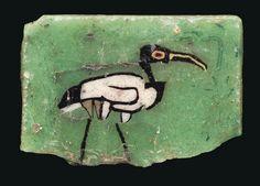 AN EGYPTIAN MOSAIC GLASS WADING IBIS INLAY.  PTOLEMAIC-ROMAN PERIOD, CIRCA 1ST CENTURY B.C.-1ST CENTURY A.D.