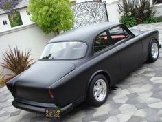 matte black with red accents, 66 volvo