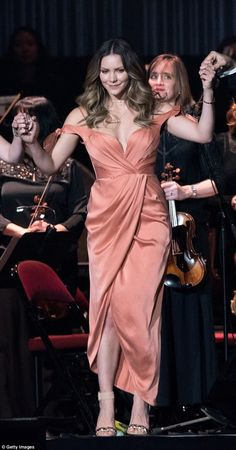 Smash hit! The Smash star, 32, stunned in a peach gown as she took to the mic to perform to a packed house at the Prudential Center