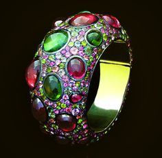 Andre Marcha 'Sultana' mixture of pink and green tourmalines set on 18k yellow gold