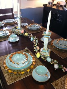Easter table setting - Anna Weatherly robin's egg blue china, Annie Glass charger and bowl and Mackenzie Childs candlesticks.