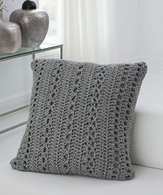 This wonderfully textured pillow will add comfort and interest to your décor. FREE PATTERN - The super bulky yarn is an on trend look and means that you can crochet it more quickly.