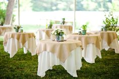 A classy, in-touch-with-nature outdoor reception. The tables look like they're floating!