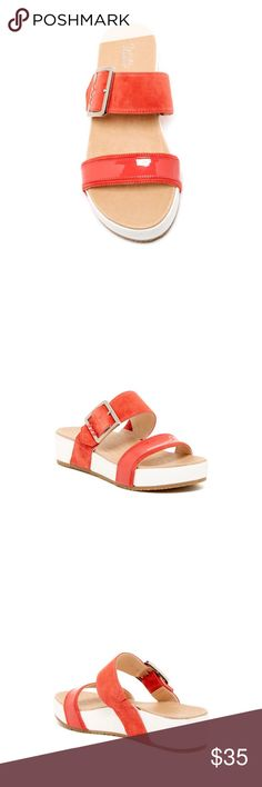 """Dr. Scholl's Frill Slide Sandals Smooth leather straps and a polished buckle take center stage on a sleek, standby slide sandal. The sophisticated style is grounded with a signature Meringue sole that does more with less and ensures all-day comfort with a soft, luxurious feel. -Open toe - Leather construction - Adjustable buckle strap detail - Slip-on - Lightly padded footbed - Wedge heel - Approx. 1.75"""" heel, 1"""" platform Leather upper and lining, synthetic sole. Worn only twice. No trades…"""