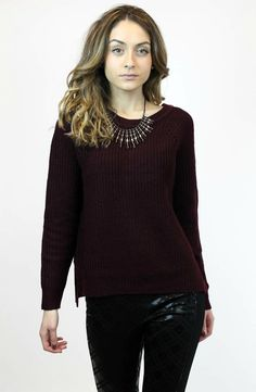Clearly, we love sweaters. And this one features a zip-up back which makes it totally chic.