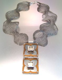 Melody Armstrong, Saskatchewan, Canada: Sterling silver, 14k yellow gold, iron pyrite, anodized titanium, patina, on titanium woven chain.