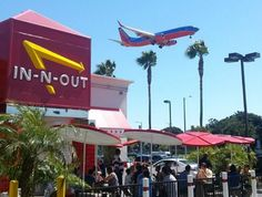 Indulge in a juicy burger while watching the jets take off and land right above you at the In-n-Out Burger near LAX, crazy. Places To Travel, Places To Go, Stuff To Do, Things To Do, In & Out, I Love La, Cali Girl, City Of Angels, California Dreamin'