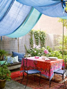 If new place don't havea patio cover could be a viable option --if i could figure out how to secure the poles9maybe I could use cocret in a ucket filled only 1/2 way put soil down then plant some climbing vine type flower-alsoif use metal rods might be cheaper then dowels/pvc just cover the poles with fabric