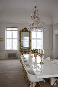white dining room. Love the chandelier.
