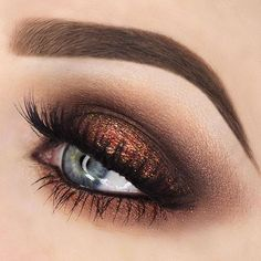 A fun look by @rebeccaseals  EYES: #abhshadows in Red Earth, Sangria, Orange Soda, Sangria & So Hollywood Illuminator  @shopvioletvoss glitter in Big Apple and Electric Love  #anastasiabeverlyhills #anastasiabrows