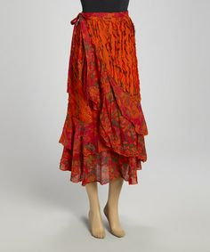 Take a look at this Orange Floral Wrap Skirt by The OM Company / Love the extra ruffles in the wrap