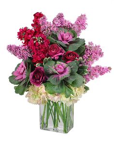 Bright spring flower arrangement with burgundy stock, fuchsia ranunculus, hydrangea, and lavender stock