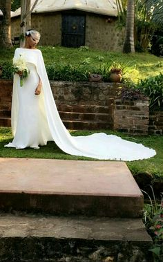 This dress though.the capè is on point,the material is super romantic.and the simplicity of the whole look makes it even sexier! Wedding Dress Trends, Wedding Gowns, Types Of Gowns, Traditional Gowns, Bridal Skirts, Bridal Cape, Bride Gowns, Bridal Fashion Week, Beautiful Bride