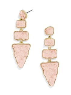Geometric shapes add interest to tiered druzy drops. Style with a sleek pony.