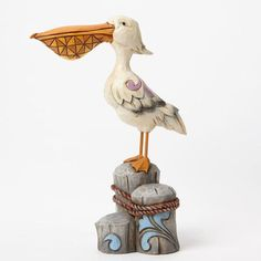 Coastal Pelican on Piling with Santa Christmas Ornament