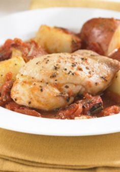 Tuscan Chicken and Potatoes – fire-roasted tomatoes and potatoes seasoned with rosemary accompany chicken thighs in this delicious one-dish baked meal.