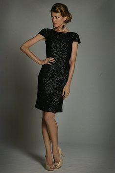 Make it your night worth reminiscing in this decadent look from Jadore J1036. This sequined cocktail dress glams in a bateau neckline designed with short sleeves. The fitted bodice flaunts a low V-back and completes the look in a knee length fitted skirt. Light up the night in this eye-catching look from Jadore. Cocktail Dresses With Sleeves, Black Cocktail Dress, Knee Length Cocktail Dress, Fitted Skirt, Fitted Bodice, Mother Of The Bride Plus Size, Sheath Dress, Bodycon Dress, Neckline Designs
