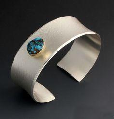 Cuff | Chris Pruitt (Laguna Pueblo, Apache). Sterling silver, 18k gold bezel and turquoise