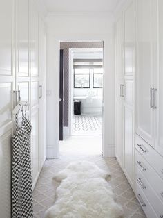 The cabinetry in this picture is from Ikea -- then dressed up with handles from Restoration Hardware. It looks fabulous!!!! transitional closet by Urrutia Design