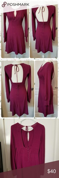Free People Magenta XSmall dress open back key hol Free People  Magenta : purple- pink color  Size 0 ( it would easily fit size 4 or even small 6) it's stretchy  Tie back,  Button back detail Key hole bust Long sleeve  Dress is new but it has this wrinkle mark, not very visible- check last photo Free People Dresses Mini