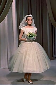 Audrey Hepburn in Funny Face.  The short Givenchy dress paved the way for fun, flirty short wedding styles that characterized the 1950's.