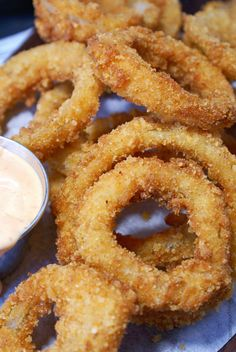 This crispy parmesan onion ring recipe is the bomb! Panko and breadcrumbs together make the perfect texture.