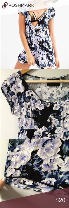 0a3e34eb32e7 Minkpink Romper This swingy romper features a floral pattern and a relaxed  fit
