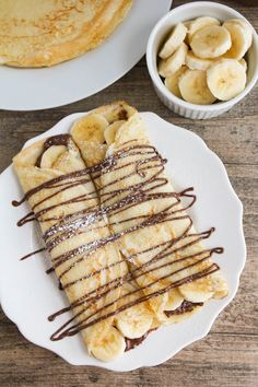 Banana Crepes + 23 Delicious Nutella Recipes These nutella banana crepes are the perfect indulgent breakfast or dessert. Super easy to make and so delicious!These nutella banana crepes are the perfect indulgent breakfast or dessert. Super easy to make and Think Food, I Love Food, Banana Crepes, Strawberry Crepes, Strawberry Desserts, Nutella Recipes, Desserts Nutella, Easy Desserts, Food Goals
