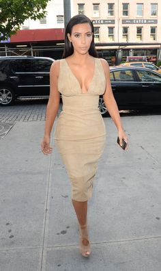 She looks like a bombshell in this body-contouring, sand-hued suede midi dress.   - MarieClaire.com