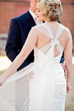 I am completely taken in with the back of this dress