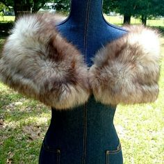 Vintage Norwegian Blue Fox Stole Shawl Bolero Beautiful genuine Norwegian Blue Fox Stole was purchased by my mother around 1967/68 and has been stored away in a non-smoking home. She hasn't worn it in years and this is so beautiful, it should be worn by someone! Fur is long and so so so soft! Satin lining is in good shape for its age, shows a little wear and some small holes see pics 3 & 4. Small pocket on each end and closure is fabric-covered hook and eye. Great for going out to dinner, a…