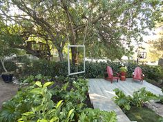 Bit of a Border: An ivy-covered fence creates a low wall for this outdoor room. Japanese holly 'Compacta' or 'Manhattan' euonmyus would be other good choices for an easily-maintained four-foot hedge.