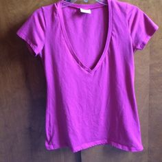 Raspberry colored deep v-neck Tshirt Raspberry colored deep v-neck tshirt from Alloy. Best picture of the actual color are the last two photos. Size large. Worn maybe twice. No imperfections or damages. Looks great with a black tank top underneath. Feel free to make an offer! Price is negotiable.  ALLOY Tops