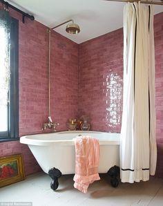 Bathroom with pink subway tile and black painted window trim - Claw foot bathtub - Wood painted floors