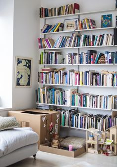 Love this. Love the shelves, the cardboard box play house, everything.