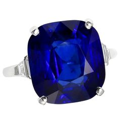 Art Deco Royal Blue No Heat Burma Sapphire and Diamond Ring. An impressive seventeen carat royal blue natural no heat sapphire ring accented with four trapezoid shaped step-cut diamonds, set in Platinum
