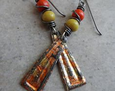 Beautiful enameled copper dangles, expertly handcrafted by an etsy artisan, are perfectly paired with artisan-made lampwork beads. Wire wrapped in solid oxidized copper wire and suspended from copper earwires, these earrings measure about 2 1/4 from end to end. You are going to love these