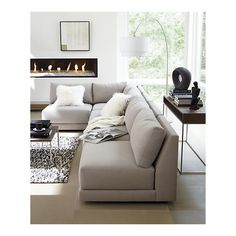 Feels warm and cosy love the neutral colours and greenery outside - don't like the sofa but like the colour of it