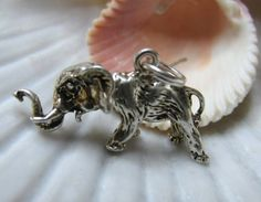 Sterling Silver Movable Elephant Charm by EverythingIOwn on Etsy, $25.00