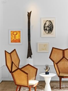 Chairs in Mahogany and Cane Flank a Marble Table