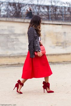 Black leather jacket, red midi skirt and red Aminah Abdul Jillil bow pumps for feminine style