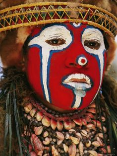 A Tribal Woman Clad with Shell Necklaces.  Papua New Guinea