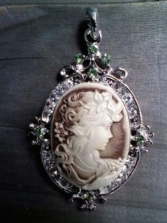 Beautiful Cameo with Crystals, I need to get one of these.