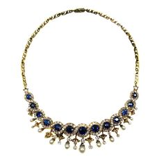Antique graduated sapphire, pearl and diamond scroll cluster necklace, c.1880