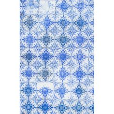 An artful anchor for a vibrant space or a touch of texture in your living room or den, this lovely woven rug features a Moroccan-inspired tile motif in blue....