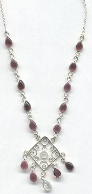 Jewelry is always a great gift idea. This Rainbow Moonstone and Garnet Sterling Silver Dreamcatcher Necklace is beautiful.