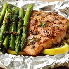 Herb Butter Salmon And Asparagus Foil Packs Baked Salmon And Asparagus, Baked Salmon Recipes, Asparagus Recipe, Seafood Recipes, Cooking Recipes, Healthy Recipes, Keto Recipes, Lemon Pepper Salmon Baked Recipe, Salmon Grilled In Foil